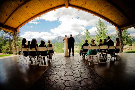 wedding couple in pavilion with guests.